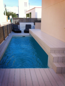 Swimming pool with bridge at family home
