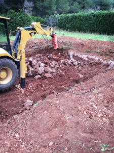 Excavator beginning swimming pool construction